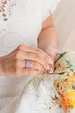 Woman hand with pink jewelry ring Royalty Free Stock Image