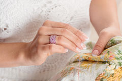 Woman hand with pink jewelry ring Stock Photo