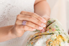 Woman hand with pink jewelry ring Stock Image