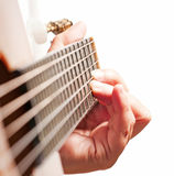 Woman hand playing guitar. Woman hand playing a classic and acoustic guitar Stock Photo