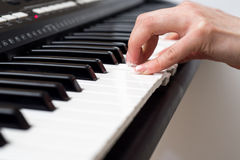 Woman hand playing a MIDI controller keyboard synthesizer close up.  Royalty Free Stock Photos