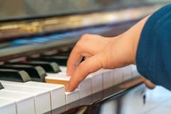 Woman hand playing piano stock images