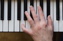 Woman hand playing piano music. Royalty Free Stock Images