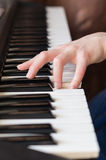 Woman hand playing piano music. Royalty Free Stock Photos