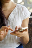 Woman hand playing smartphone Royalty Free Stock Image