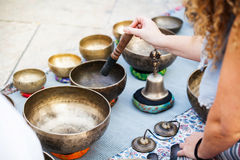 Woman hand playing yoga bowls outdoors. Royalty Free Stock Photography