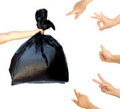 Woman hand pointing and accepting at woman hand holding garbage bag isolated Stock Photography