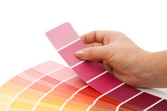 Woman hand pointing to a sample color chart Royalty Free Stock Photos
