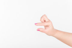 Woman Hand with Polish Fingers on White Background. Shows and Empty Space for Small Peace of Item. Royalty Free Stock Image