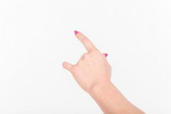 Woman Hand with Polish Fingers on White Background. Shows and Sign And Gesture Towards Royalty Free Stock Image