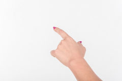 Woman Hand with Polish Fingers on White Background. Shows Sign And Gesture Towards Royalty Free Stock Photos