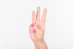 Woman Hand With Polish Nails Show Three Fingers. White Bakcground. Woman Hand With Polish Nails Show Three Fingers. White Bakcground royalty free stock image