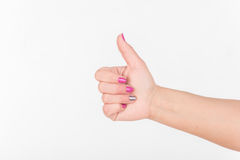 Woman Hand With Polish Nails Show Thumbs Up. White Bakcground. Woman Hand With Polish Nails Show Thumbs Up. White Bakcground stock photo