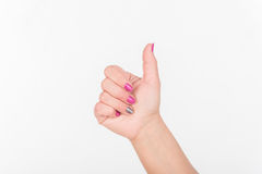 Woman Hand With Polish Nails Show Thumbs Up. White Bakcground. Woman Hand With Polish Nails Show Thumbs Up. White Bakcground royalty free stock images