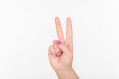 Woman Hand With Polish Nails Show Two Fingers. White Background. Stock Photography