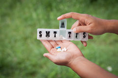 Free Woman Hand Pouring Pills From A Pill Reminder Box Into Her Hand Royalty Free Stock Image - 59700296