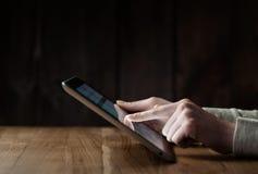 Woman hand presses on screen digital Stock Image
