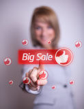 Woman hand pressing BIG SALE button Stock Image
