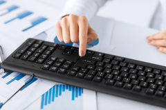 Woman hand pressing enter button on keyboard Stock Images