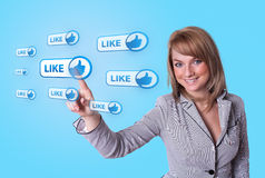 Woman hand pressing Social Network icon. On blue background Royalty Free Stock Photo