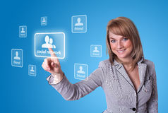 Woman hand pressing Social Network icon. On blue background Royalty Free Stock Images