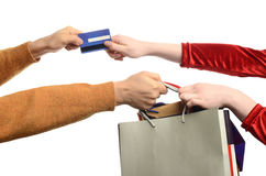 Woman hand pulling the shopping bags, man hand pul Royalty Free Stock Images