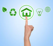 Woman hand push green button. Woman hand push environmental green house button stock photo