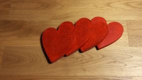 Woman hand pushes red heart shape, all shapes fall. Domino effect. Relationship, result or consequences concepts. 4K stock video