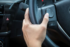 A woman hand pushes the volume control button Royalty Free Stock Photography