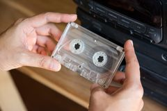 Put cassette tape player. Woman hand put cassette tape player royalty free stock images