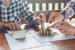 Woman hand put coins to stack of coins, a saving money for fut stock photography