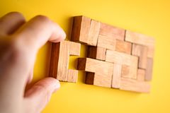 Woman hand put wooden blocks for finishing task Royalty Free Stock Photos