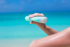 Woman hand putting sunscreen from a suncream Royalty Free Stock Photo