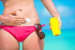 Woman hand putting sunscreen from a suncream Royalty Free Stock Images
