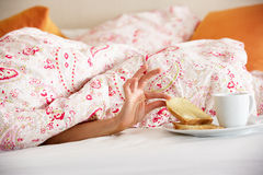 Woman Hand Reaching From Under Duvet Royalty Free Stock Image