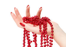 Woman hand with red glassbeads closeup stock image
