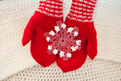 Woman hand in red gloves holding white big snowflake Royalty Free Stock Photo