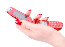Woman hand with red mobile phone Stock Image