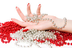 Woman hand with red and silver glassbeads Stock Photography