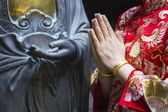 Woman hand respect to buddha statue. Woman hand respect to buddha statue Royalty Free Stock Image