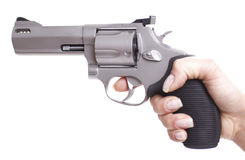 Woman hand with revolver. Woman hand with silver revolver Royalty Free Stock Image