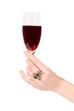 Woman hand with ring holding glass of wine Royalty Free Stock Photography