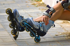 Woman hand on a rollerblades. In a autumn park Stock Photo