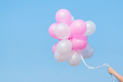 Woman hand's holding many balloons Royalty Free Stock Image