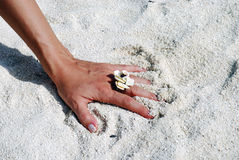 Woman hand in the sand Royalty Free Stock Photography