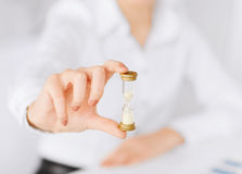 Woman hand with sandglass Stock Photography