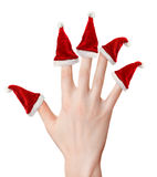 Woman hand with santa hats royalty free stock images