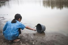 Woman hand are scooping water on cracked ground. Woman hand are scooping water on cracked ground, Crisis of water shortage royalty free stock images