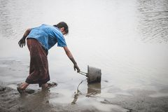 Woman hand are scooping water on cracked ground. Woman hand are scooping water on cracked ground, Crisis of water shortage royalty free stock photography