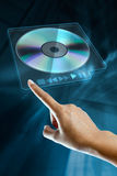 Woman hand on screen. A woman hand press eject dvd n on a digital screen Stock Image